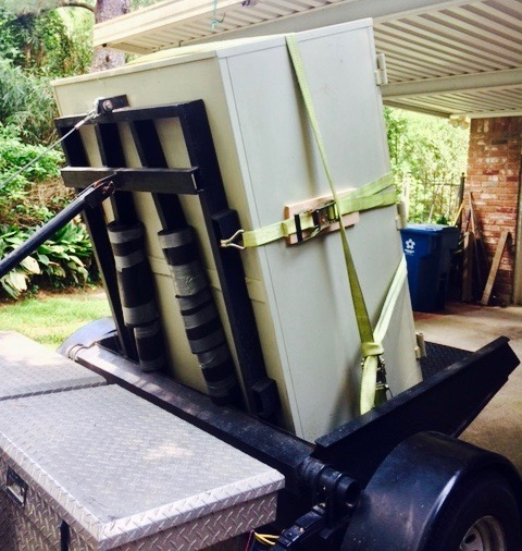 Safe Locksmith in Montgomery TX moving and delivering a safe on a safe trailer