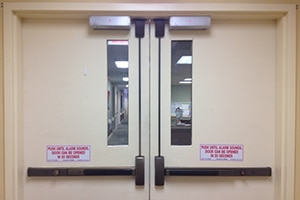 Double doors with panic devices serviced by your Commercial Locksmith in Montgomery TX