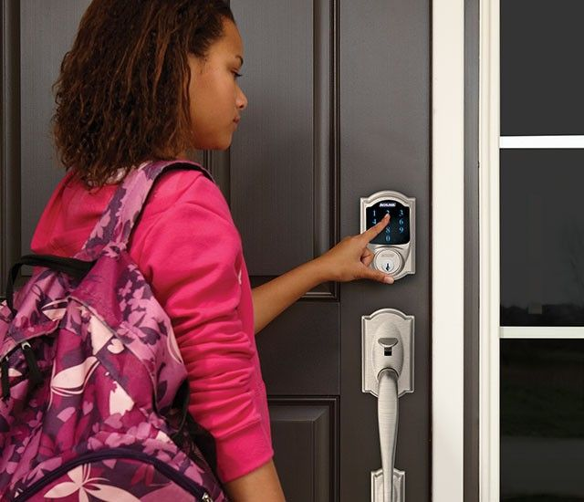 Smart lock with digital keypad on a residential front door